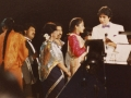 Mahesh Gadhvi, Amitabh Bachchan and Kumar Sanu on stage